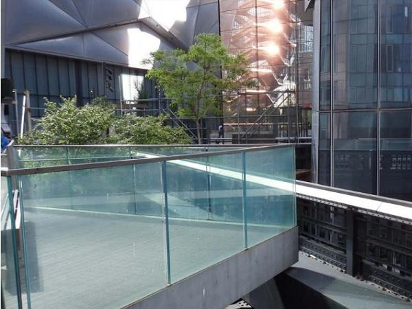 Enhanced Effective Thickness Method for Cantilevered Laminated Glass Balustrades