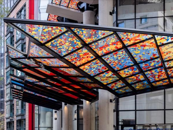 For passers-by it is like walking through a rain of confetti under the printed canopies. Photo: Simon Kennedy